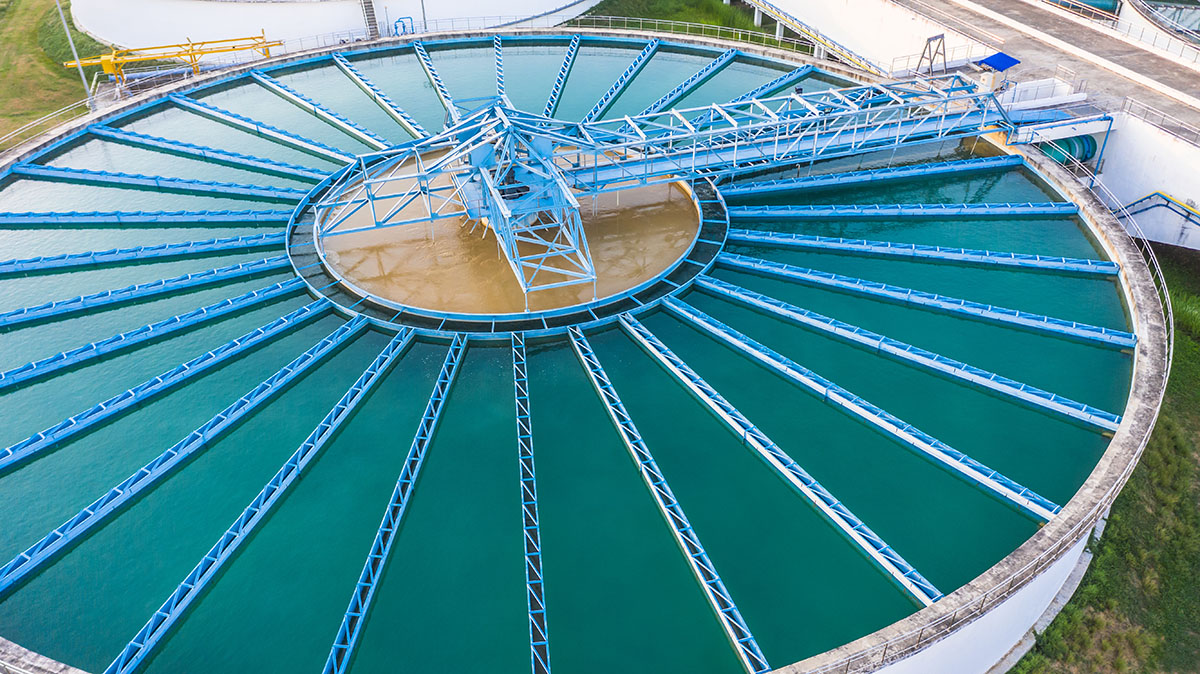 Aerial view of solids contact clarifier for water treatment at an industrial plant.