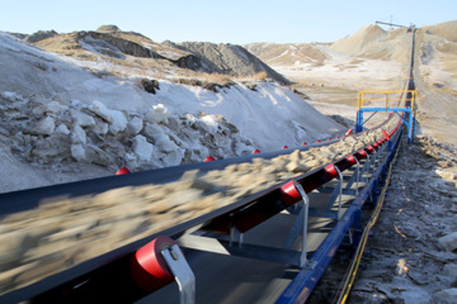 Conveyor belt carrying minerals to processing plant, drying aid, freeze protect, mineral process